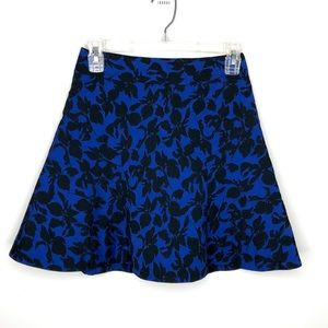 Express mini skirt blue with black floral pattern